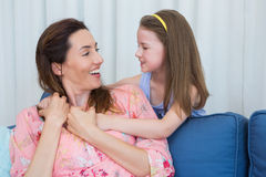 Mother and daughter smiling at each other Stock Photography
