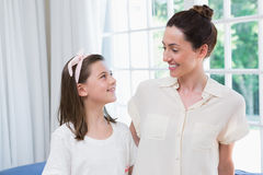 Mother and daughter smiling at each other Royalty Free Stock Photo