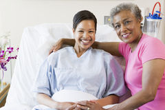 Mother And Daughter Smiling In Hospital Stock Photography