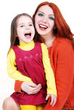 Mother and daughter smiling i Stock Images