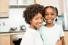 Mother and daughter smiling in the kitchen Royalty Free Stock Images