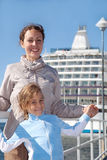 Mother daughter smiling near ship stock images