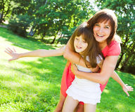 Mother and daughter smiling outdoor. Stock Photography