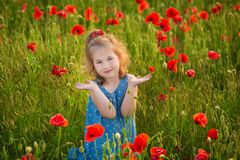 Mother and daughter smiling in a poppy field. The Picnic in the poppy field. Walk with family in poppy field. The cart poppies Royalty Free Stock Photography