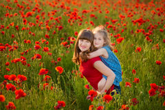 Mother and daughter smiling in a poppy field. The Picnic in the poppy field. Walk with family in poppy field. The cart poppies stock photography
