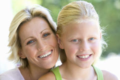 Mother and daughter (8-10), smiling, portrait Royalty Free Stock Photo