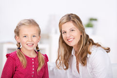 Mother and daughter smiling Stock Images