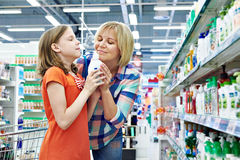 Mother and daughter sniff fragrance shampoo Royalty Free Stock Images