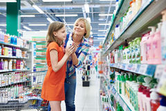 Mother and daughter sniff fragrance shampoo Royalty Free Stock Image