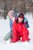 Mother with  daughter in snow Royalty Free Stock Images