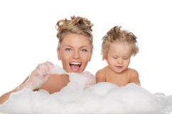 Mother with daughter and soap foam Royalty Free Stock Images