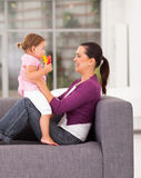Mother daughter on sofa Royalty Free Stock Photography