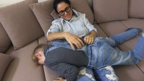 Mother with daughter on sofa stock video footage