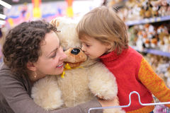 Mother with daughter and soft toy Royalty Free Stock Photo