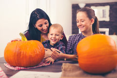 Mother with daughter  and son creating big pumpkin Stock Photography