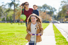 Mother daughter and son family in the park Royalty Free Stock Image