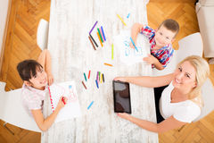 Mother and daughter and son at home Royalty Free Stock Image
