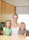 Mother with daughter and son in the kitchen together Royalty Free Stock Photography