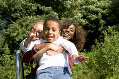 Mother, daughter and son on playground slide Royalty Free Stock Photography