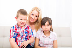 Mother with daughter and son relaxing Stock Images