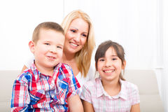 Mother with daughter and son relaxing Royalty Free Stock Photography