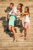 Mother with daughter and son walking on stairs in city and watch Royalty Free Stock Images