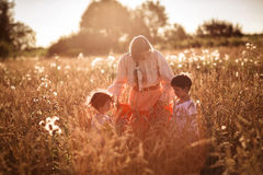 Mother and daughter and son in a wheat field Stock Images