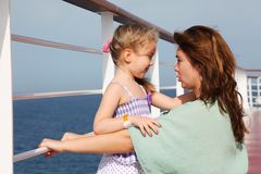 Mother and daughter speaking on cruise liner deck Stock Image