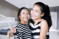 Mother and daughter having fun with face painting Stock Photography