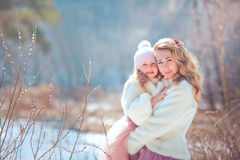 Mother with daughter in spring park. Beautiful mother with daughter in spring park Royalty Free Stock Images
