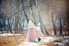 Mother with daughter in spring park. Beautiful mother with daughter in spring park Royalty Free Stock Photos