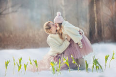 Mother with daughter in spring park. Beautiful mother with daughter in spring park Royalty Free Stock Photo
