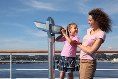 Mother and daughter stand on deck of ship Stock Photos