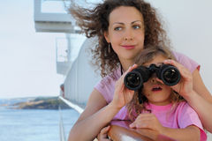 Mother and daughter stand on ship board Royalty Free Stock Images