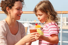 Mother and daughter standing on cruise liner deck Stock Photo