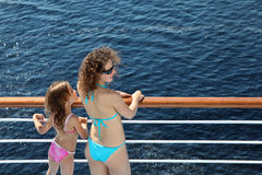 Mother and daughter standing on deck of ship Royalty Free Stock Images