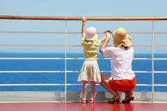 Mother and daughter standing on deck of yacht Royalty Free Stock Images