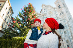 Mother and daughter standing near Christmas tree in Florence Royalty Free Stock Photo