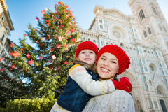 Mother and daughter standing near Christmas tree in Florence Stock Photos
