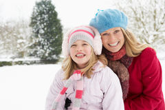 Mother And Daughter Standing Outside In Snowy Land Royalty Free Stock Photo