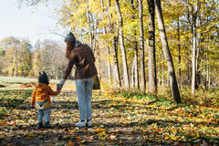 Mother and daughter standing in the park Stock Photos