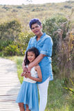 Mother and daughter. Standing portrait royalty free stock photos