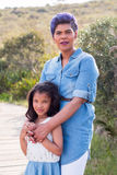 Mother and daughter. Standing portrait stock image