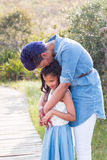 Mother and daughter. Standing portrait kiss royalty free stock images