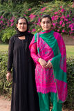 Mother and daughter standing at Qutub Minar, Delhi, India Stock Photo