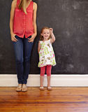 Mother and daughter standing together - Indoors Royalty Free Stock Photo