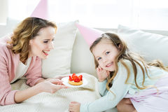 Mother and daughter with strawberry cake Stock Photo