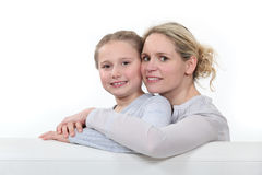 Mother and daughter in a studio Stock Photos