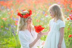 Mother and daughter at summer field. Happy family on nature. Royalty Free Stock Photo