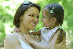 Mother with daughter in summer Stock Images